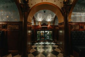 THE GRAND HALL – PRIVATE HIRE ROOM Stepping through the secret door and in to The Grand Hall lies a room laden with marble and eccentricity. Perfect for larger gatherings who aren't looking to take over the whole bar. With you very own fridge filled to the brim with your favourite tipples  This space is perfect for parties with up to 40 guests