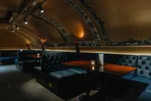 THE VAULT – PRIVATE HIRE AREA AVAILABLE Follow the steps down to the lavish Vault, complete with wood cladded walls and golden arches. The perfect place to impress your fellow comrades with your very own fridge and leather padded booth seating.  Great for parties with up to 70 guests